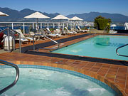 Pan Pacific Vancouver - Outdoor pool and hot tub with a view.