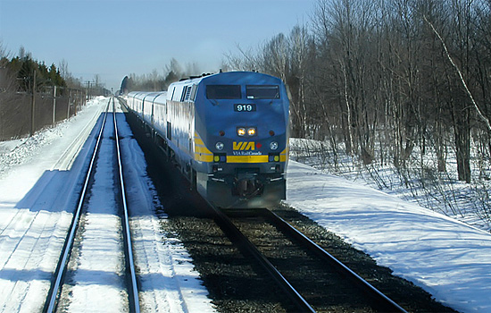 VIA Rail train travels over barren winter landscape on the way to Hudson Bay