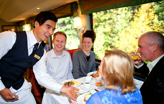 Dinner service onboard the Rocky Mountaineer train