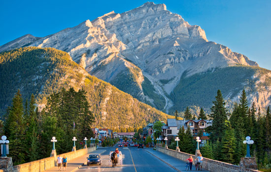 Banff in summer with a view of Cascade Mountain at the end of the town