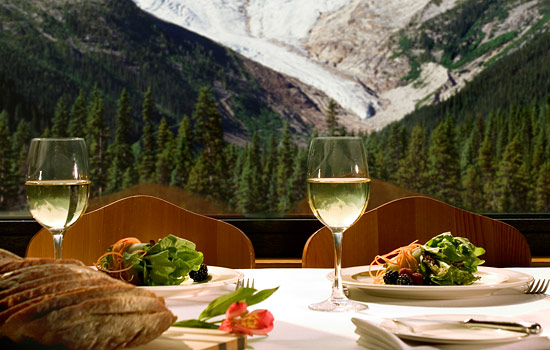 Gourmet dinner with wine and a mountain view