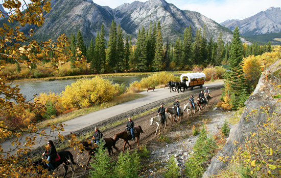Horseriding along a river in Banff