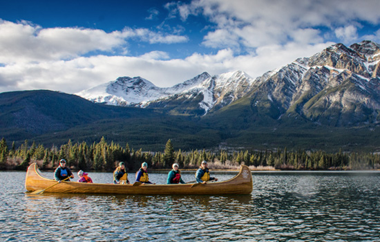 Choose to bask in the serene atmosphere of the Rockies on a guided canoe tour in Jasper.
