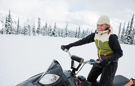 Choose a snowmobiling adventure through beautiful snow-covered trails of the Canadian Rockies.