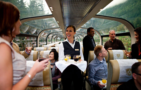 Gold leaf passengers are served complimentary drinks onboard the Rocky Mountaineer dome car