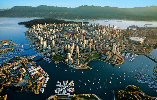 Birds-eye-view of mountains, oceans surrounding the city of Vancouver