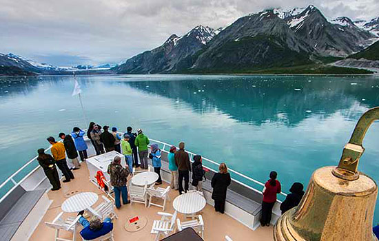 From the top deck of the Safari Endeavour, passengers view the passing landscape on a Alaskan cruise