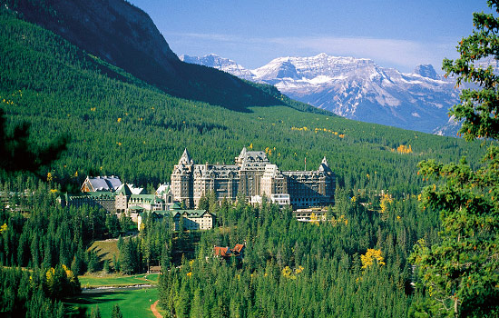 The Fairmont Banff Springs hotel surrounded by the mountains and forests of the Canadian Rockies