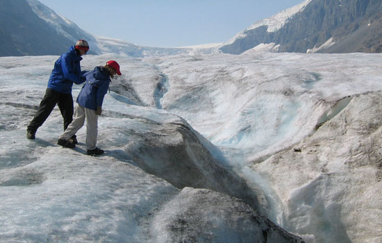 Choose to stop for a walk along the largest mass of ice in the Rocky Mountains - the Columbia Icefields.