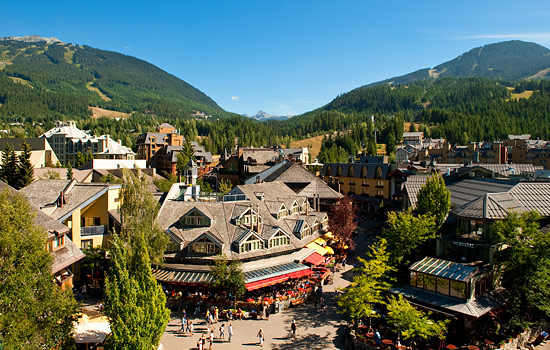 Whistler Village in the summertime sits at the base of Whistler and Blackcomb mountains