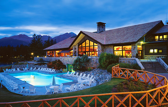 Exterior of pool at Fairmont Jasper Park Lodge in the evening