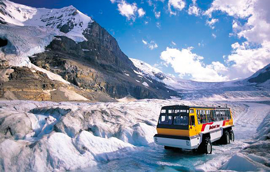 At the Athabasca Glacier in the Columbia Icefields, an Ice Explorer bus stands parked in the snow