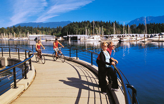 Visitors biking around Stanley Park in Vancouver