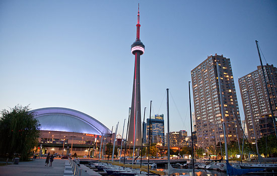 Toronto's CN tower lit up in the evening