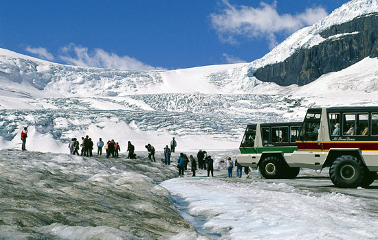 Visitors to the Rockies take a guided tour on a glacier along the Icefields Parkway