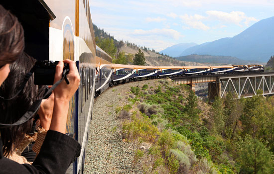 Taking photos on the viewing platform onboard the Rocky Mountaineer