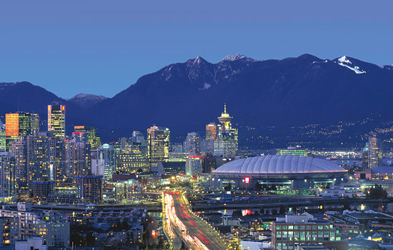 You arrive in Vancouver and are welcomed by beautiful ocean and mountain vistas.