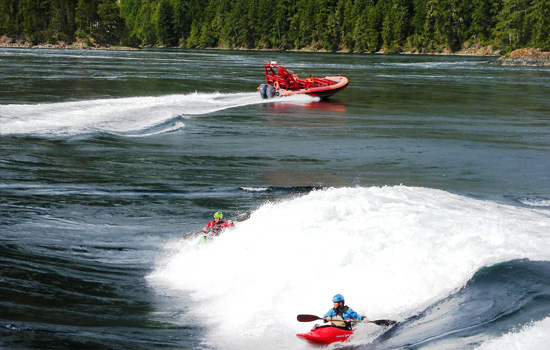 Kayakers practice on the Skookumchuk rapids