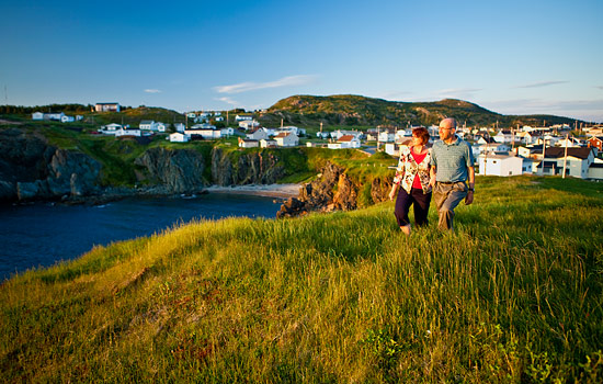 A couple take stroll along the cliffs in Newfoundland