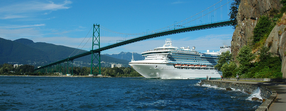 Departing Vancouver's Waterfront, a cruiseship sails beneath the Lions Gate Bridge bound for Alaska.